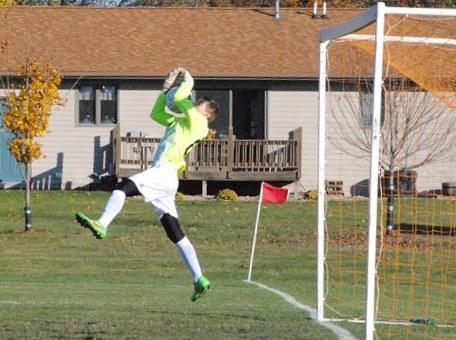 marshfield columbus catholic soccer goalkeeper kellen heinzen la crosse aquinas wiaa division 4 boys soccer sectional semifinal save