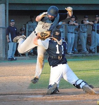 Marshfield Post 54's Jack Donahue is tagged out at home plate by Wausau catcher Paul Weise during the third inning of Tuesday night's game at Jack Hackman Field. Wausau won 9-3.