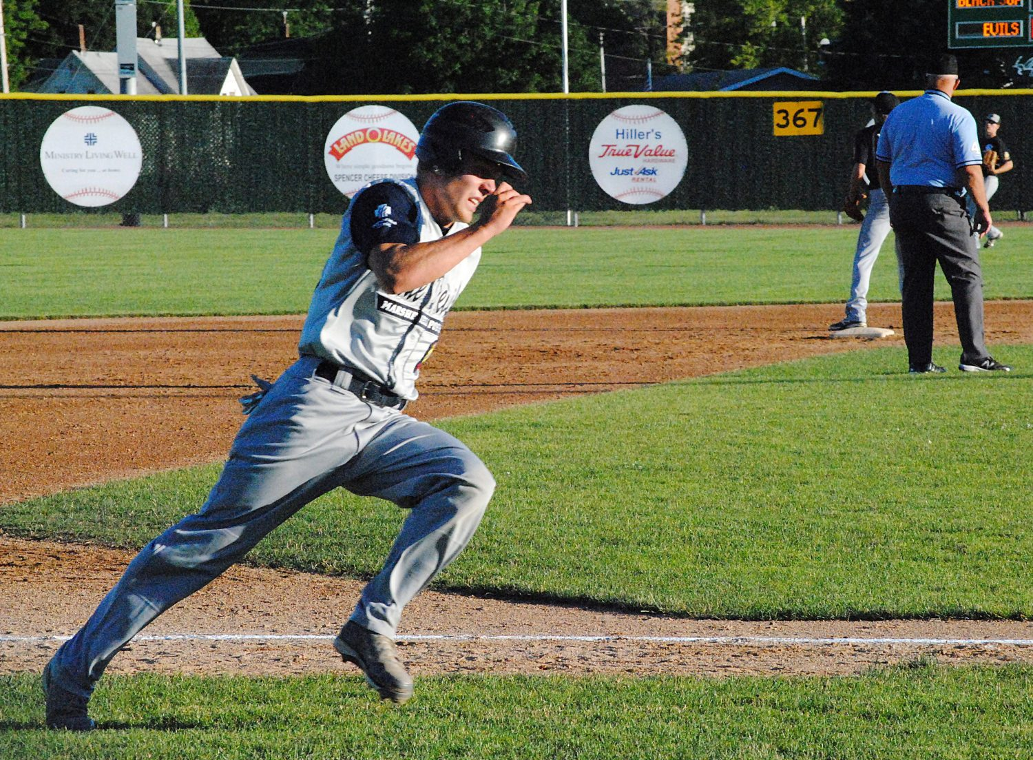 Marshfield Clinic Post 54's Braden Bohman flies around third base to score the Blue Devils' ninth run in a big first inning as they rolled past Plover 20-7 in a Legion baseball game Tuesday night at Jack Hackman Field in Marshfield.
