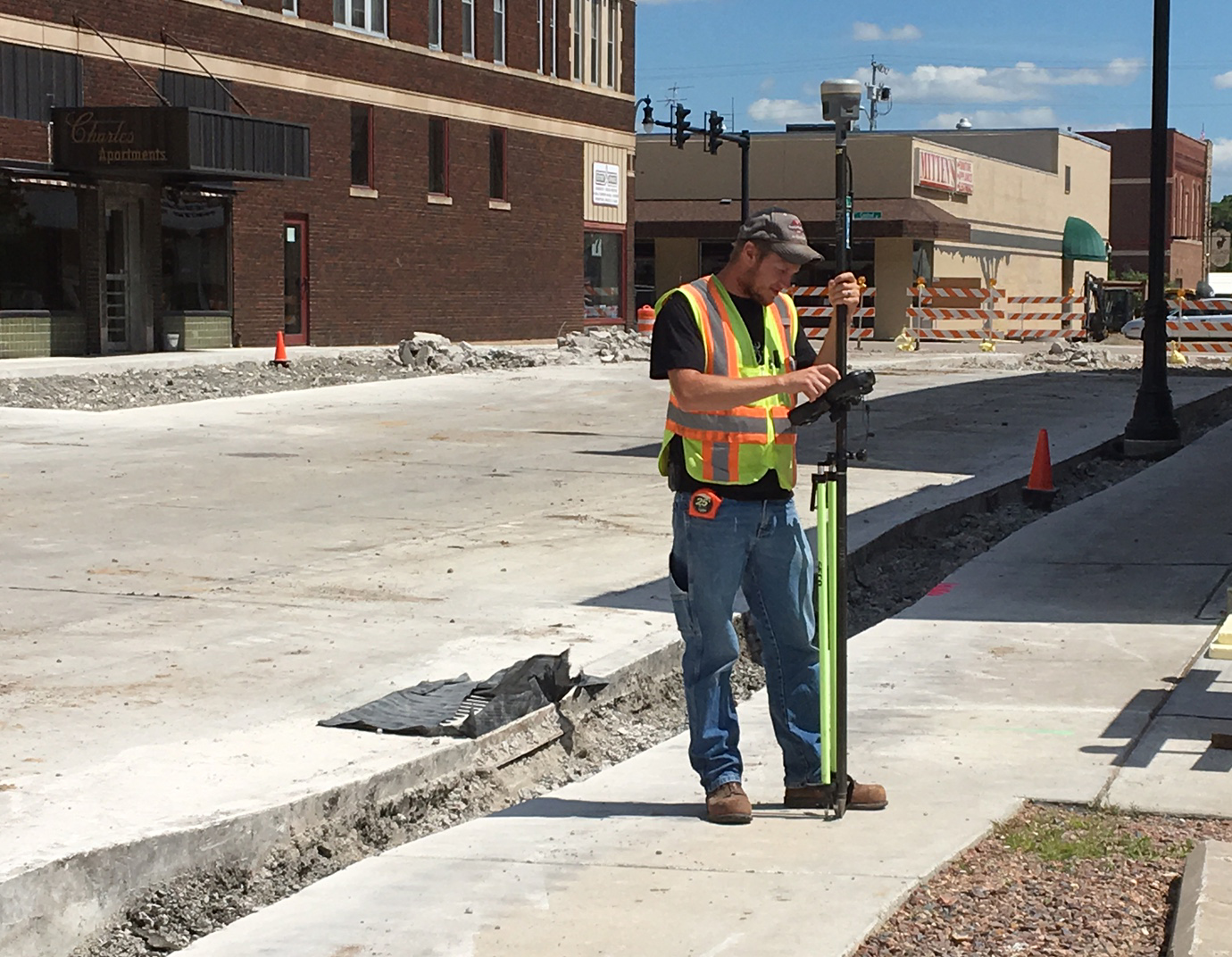 City of Marshfield employee Shawn Miller works on the conversion of Second Street between Central and Chestnut Avenues into a one-lane avenue.