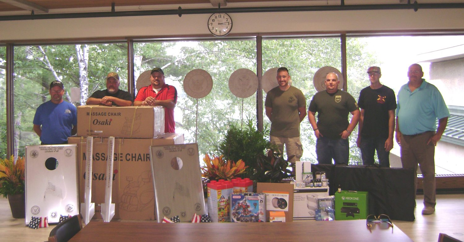 A&B Process Systems military veterans donate equipment for the PTSD Day Room at the Wisconsin Veterans Home at King. Pictured from left to right are Mike O''Shaughnessy, Scott Voda, Curt Tuttle, Nate Lange, Jay Kroeplin, Beau Krostag, and Mike Krostag.