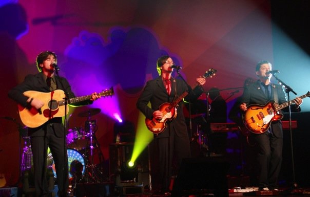 Ryan, Matthew, and Billy McGuigan perform in Yesterday and Today: The Interactive Beatles Experience.