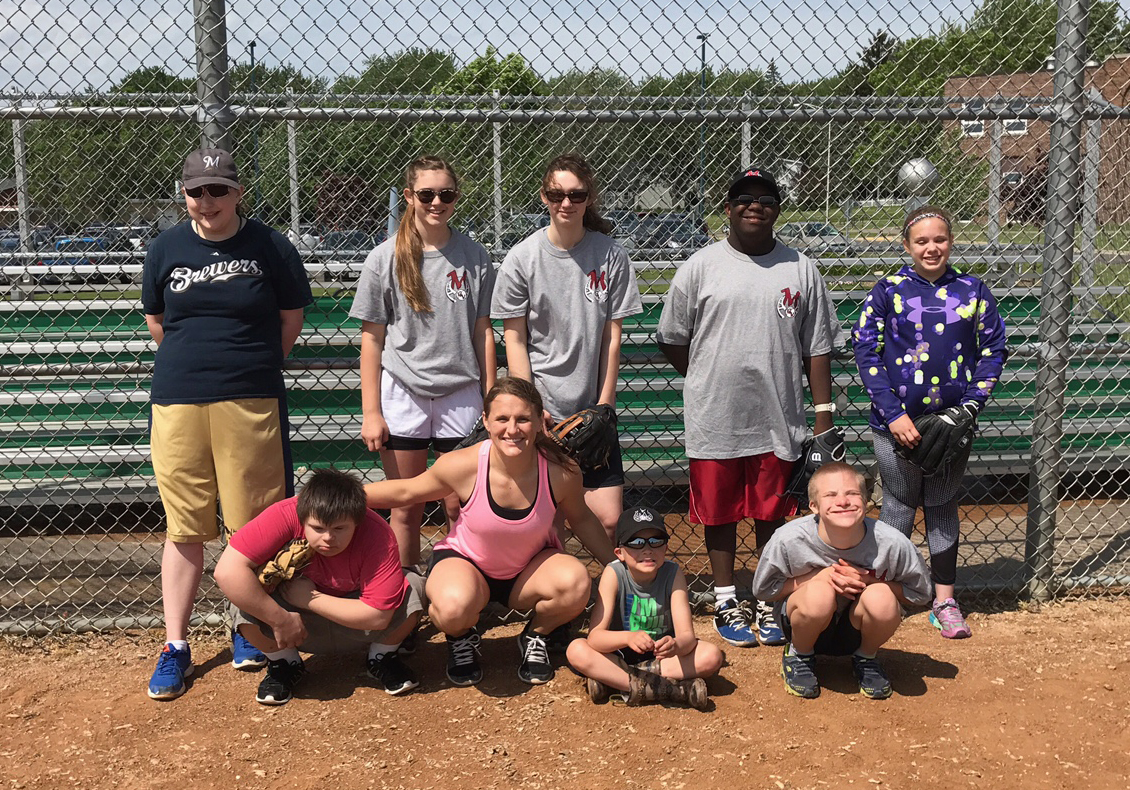 Five participated in the first annual Every Child Deserves a Chance to Play event on June 3. Pictured are players and volunteers.