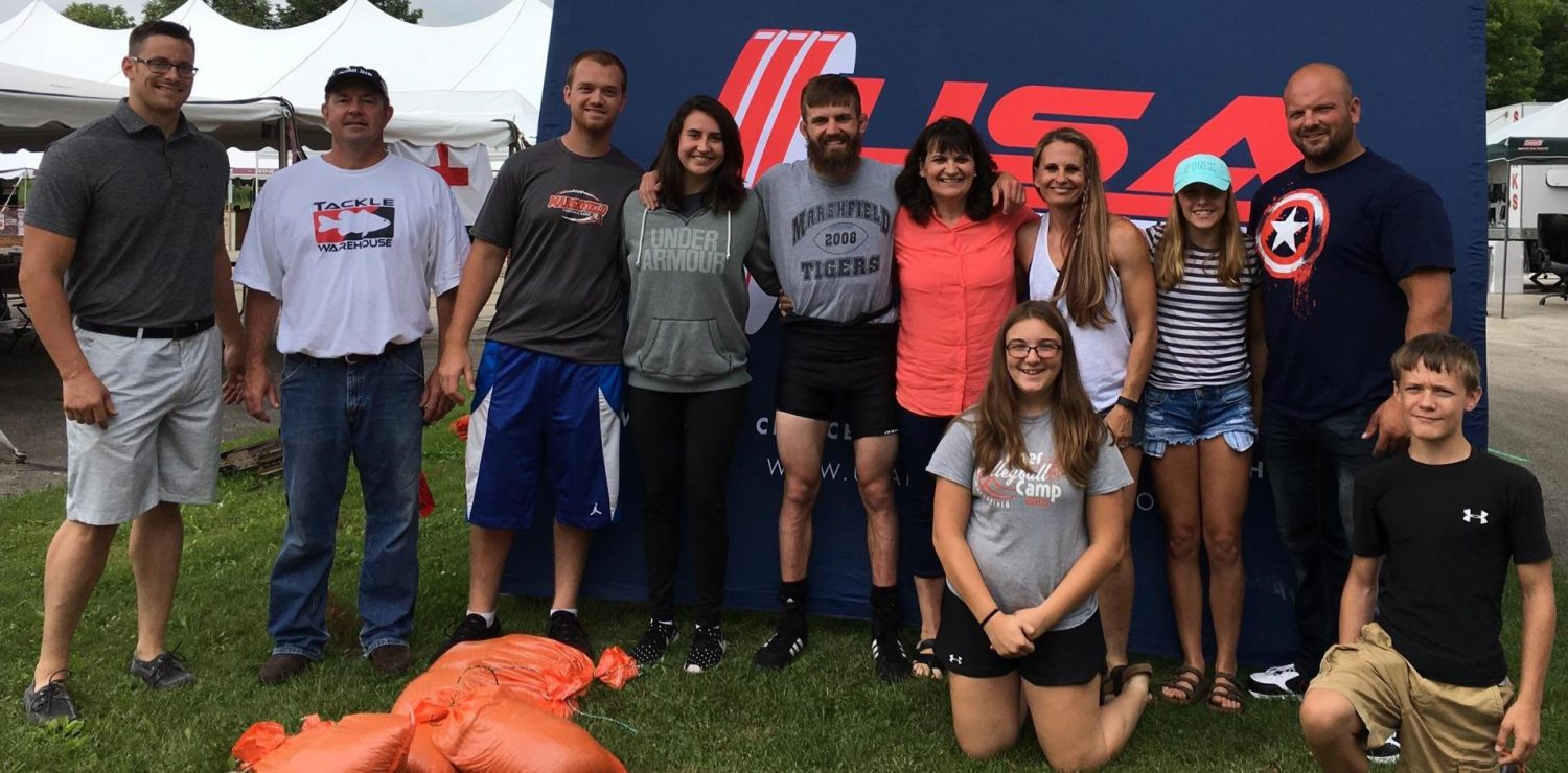 Marshfield native Mack Scheppler, fifth from left, is surrounded by supporters after breaking two state records at the USA Powerlifting meet in Cudahy on July 22. Standing, from left, are Ben Wright, Matt Scheppler, Travis Lutz, Jenny Scheppler, Mack Scheppler, Kathy Scheppler, Becky Holland, Gracie Holland, and Carl Foemmel. Kneeling are Jenna Foemmel and Garret Holland.