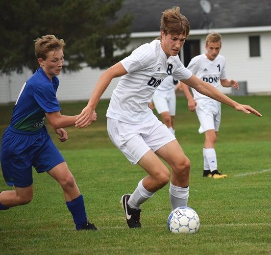 Columbus Catholic's Noah Hansen controls the ball during the Dons' game against McDonell/Regis on Tuesday at Griese Park.